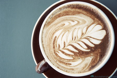 Latte art is made with steamed milk used to cut espresso drinks.